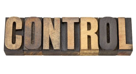 control - isolated word in vintage letterpress wood type Stock Photo - 13599824