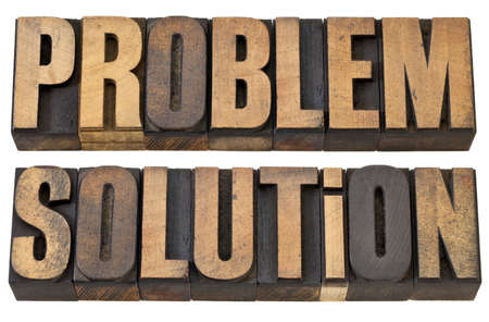 problem and solution - isolated words in vintage letterpress wood type Stock Photo - 13599829