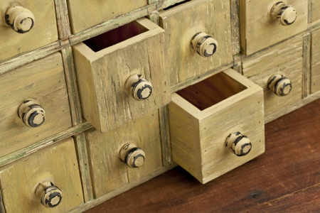 drawers: drawers of primitive vintage grunge wood apothecary cabinet Stock Photo