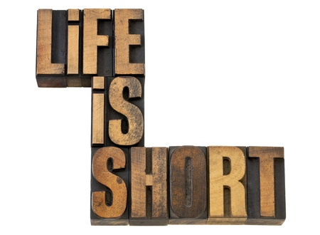 life is short phrase wisdom reminder - isolated text in vintage letterpress wood type Stock Photo - 13604647