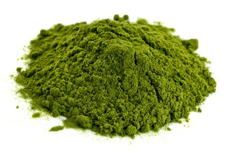 a small pile of green freeze-dried organic wheat grass powder, nutritional supplement Stock Photo