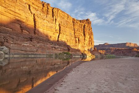 Colorado River at sunrise in Canyonlands National Park with rock cliffs and sandbar Stock Photo - 13637072