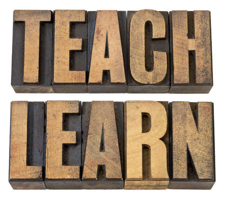 teach and learn - education concept - isolated words in vintage letterpress wood type Stock Photo - 13671492