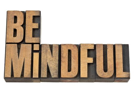 Be mindful  - isolated text in vintage letterpress wood type Stock Photo - 13710269