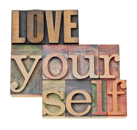 self esteem: love yourself - self esteem concept - isolated text in vintage letterpress wood type Stock Photo