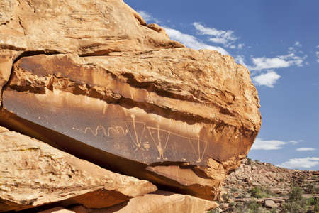 ancient rock art with a snake and  triangular anthropomorphic  human  figures  the Formative to the historic Ute period  near Moab, Utah