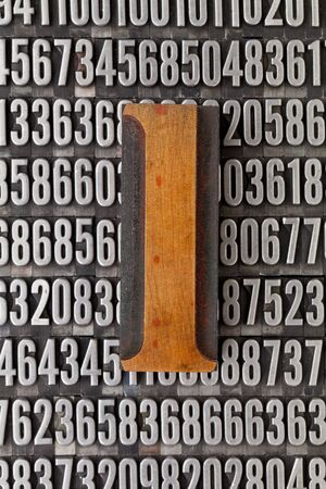 number one in vintage letterpress wood type against background of random metal numbers Stock Photo - 13794920