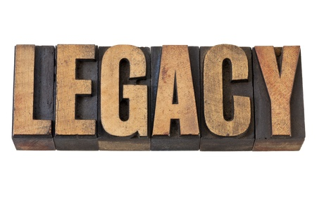 tradition: legacy - isolated word in vintage letterpress wood type Stock Photo