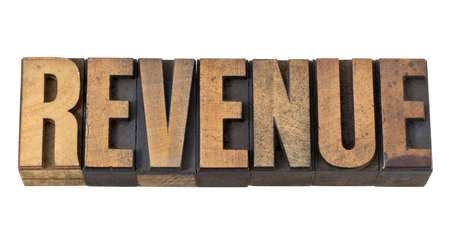 revenue - financial concept - isolated word in vintage letterpress wood type Stock Photo - 13831103