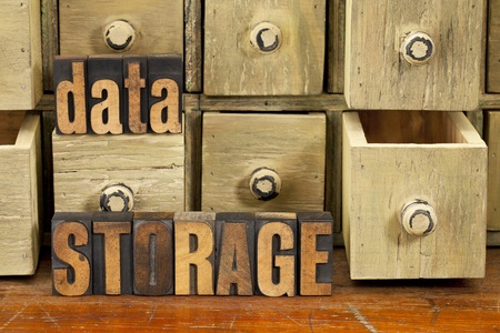 data storage concept - words in vintage letterpress wood type and primitive rustic wooden apothecary drawer cabinet Stock Photo - 13927284