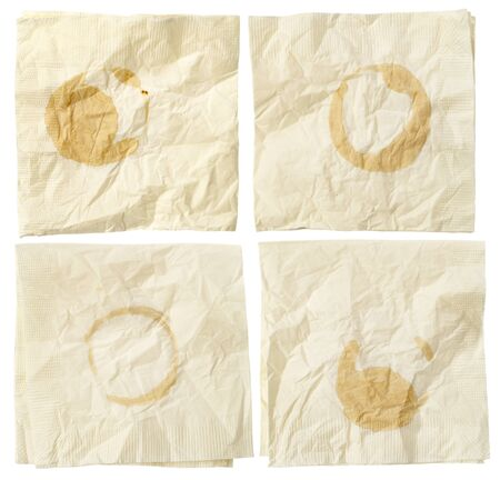four paper wrinkled napkins with coffee stains isolated on white