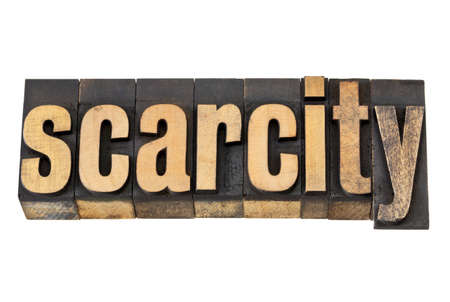 scarcity: scarcity - isolated text in vintage letterpress wood type Stock Photo