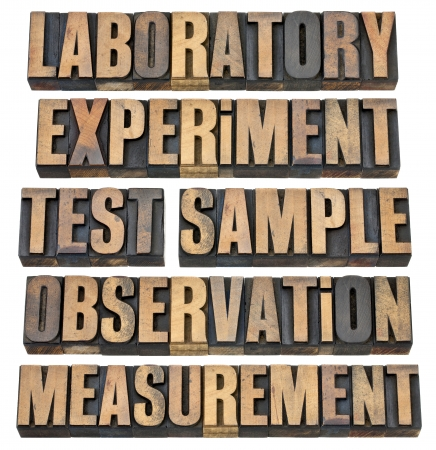 a collage of words related to experimental research - laboratory, experiment, test, sample, observation, measurment - isolated text in vintage letterpress wood type photo