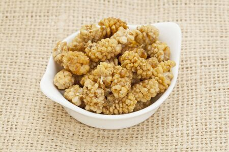superfruit: sun-dried white mulberry berries in a small ceramic bowl