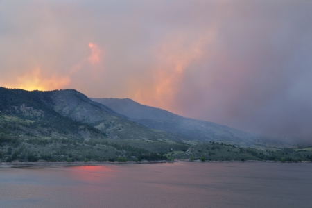 heavy smoke from High Park wildfire obscuring the sun and sky over Horsetooth Reservoir and foothills near Fort Collins, Colorado Stock Photo - 14007152