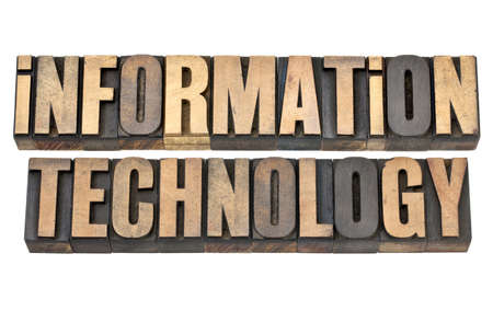 information technology - IT concept - isolated text in vintage letterpress wood type Stock Photo - 14007154