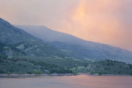 heavy smoke from High Park wildfire obscuring the sun and sky over Horsetooth Reservoir and foothills near Fort Collins, Colorado, June 10, 2012 Stock Photo - 14143731
