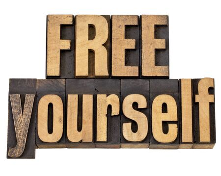 yourself: free yourself - spiritual concept - isolated text in vintage letterpress wood type