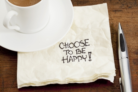 hapiness: choose to be happy advice - a doodle handwriting on a napkin with a cup of coffee