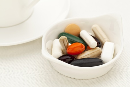 bowl of vitamin, supplement  and medicine pills - breakfast concept - shallow depth of field Stock Photo - 14063401