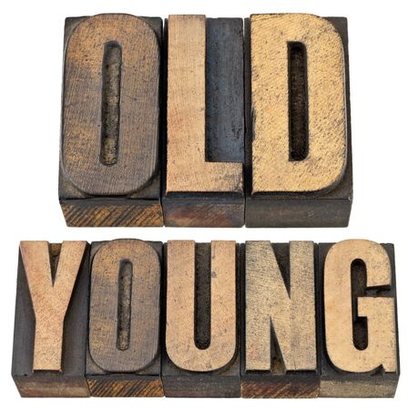 old and young antonym - age or generations concept -- isolated text in vintage letterpress wood type Stock Photo - 14063190