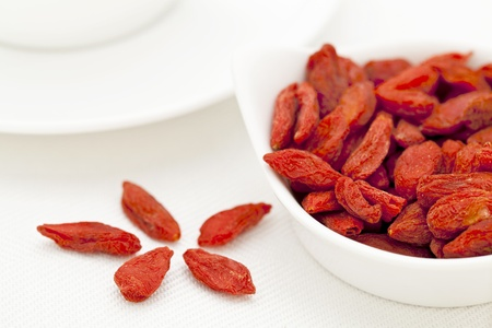 organic dried goji berries (wolfberry) in a small ceramic bowl - Tibetan superfood photo
