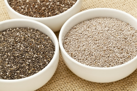 chia seeds in white ceramic bowls - three varieties including white chia Stock Photo - 14167353