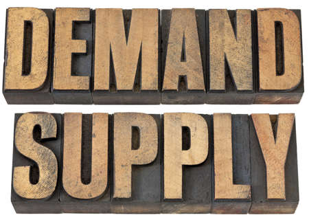 on demand: demand and supply words - isolated text in vintage letterpress wood type Stock Photo