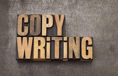 copywriting: copywriting word - vintage letterpress wood type on a grunge metal background