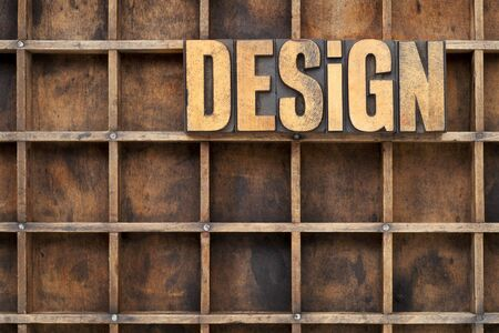design word in vintage letterpress wood type against divider pattern of a grunge typesetter case Stock Photo - 14414139