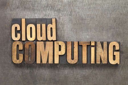 cloud computing - text in vintage letterpress wood type against a grunge metal sheet Stock Photo - 14414147