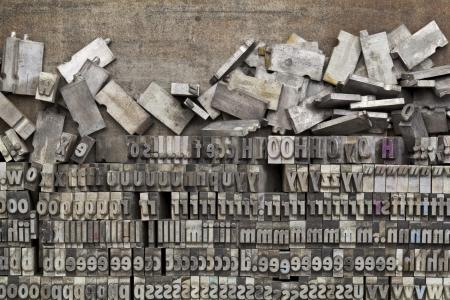 disorganized vintage grunge metal letterpress printing blocks on a tray Stock Photo - 14414146