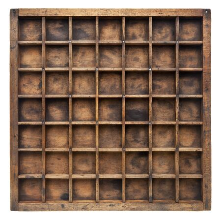drawers: vintage wood  printer  (typesetter) drawer with numerous dividers, isolated on white