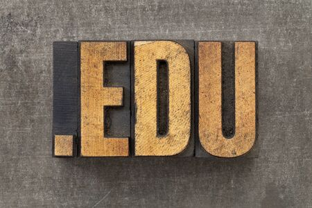 edu: dot edu - internet domain for education in vintage wooden letterpress printing blocks on a grunge metal sheet Stock Photo