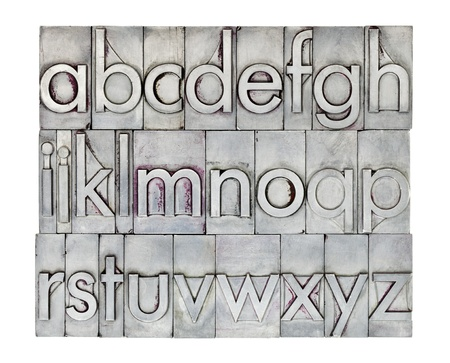 metal: lowercase English alphabet  in vintage metal letterpress type, square composition isolated on white