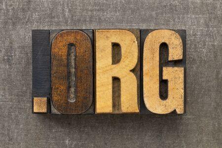 dot org - internet domain for nonprofit organization in vintage wooden letterpress printing blocks on a grunge metal sheet Stock Photo - 14461830