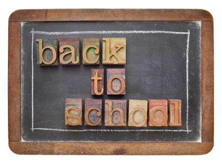 back to school concept - text in vintage letterpress wood type on a slate blackboard photo