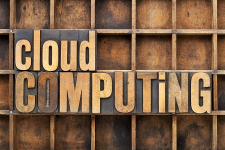 cloud computing - text in vintage letterpress wood type against a grunge metal sheet Banco de Imagens
