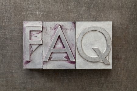 frequently: FAQ  frequently asked questions  acronym - text in vintage letterpress metal type against a grunge steel sheet