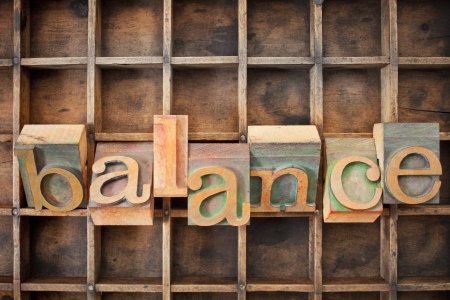 balance word in twisted vintage letterpress wood type against a grunge typesetter box Stock Photo - 14577586