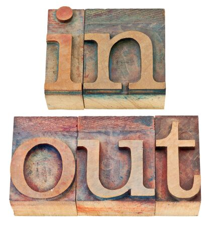 in and out - isolated words in vintage letterpress wood type Stock Photo - 14780614