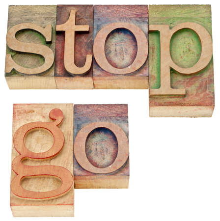 stop and go - isolated words in vintage letterpress wood type Stock Photo - 14780615