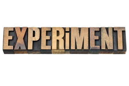 experiment - isolated word in vintage letterpress wood type Stock Photo - 14780610