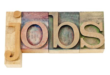 jobs - isolated text in vintage letterpress wood type stained by color inks photo
