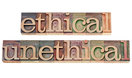 unethical: ethical and unethical words - isolated text in vintage letterpress wood type stained by color inks Stock Photo