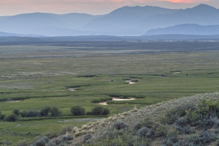 Illinois River meanders through Arapaho National Wildlife Refuge, North Park near Walden, Colorado, late summer scenery at dusk Stock Photo - 15195927