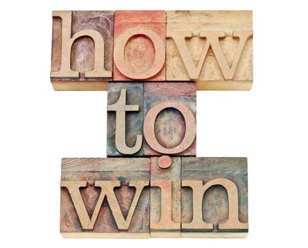 how to win - isolated text in vintage letterpress wood type stained by color inks Stock Photo - 15195931