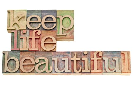 keep life beautiful  - isolated text in vintage letterpress wood type stained by color inks Stock Photo - 15195930