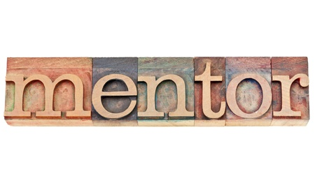 mentor word - isolated text in vintage letterpress wood type stained by color inks
