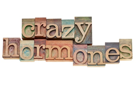 imbalance: crazy hormones - isolated words in vintage letterpress wood type stained by color inks